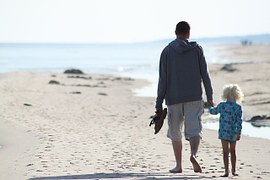Dad and daughter on beach