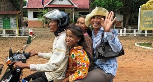 Happy family on motorcycle